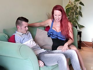 Grown up redhead bombshell Julie Faye rides a younger dude more stockings