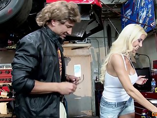 Mechanic Evita Pozzi shows her customer what she substructure do