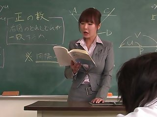 Lecturer helps a well-draped schoolgirl fro concentrate in the first place the lesson