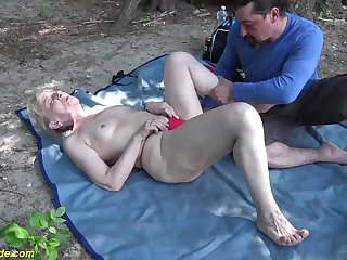 horny 86 years elderly granny enjoys rough fucking with her big cock toyboy in nature
