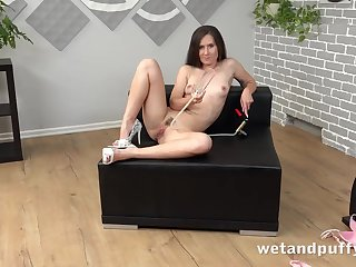 Chick with a trimmed twat plays with her toys