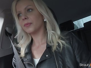 Nice blond hitchhiker Julia Parker gives a blowjob round the car to one kinky stranger