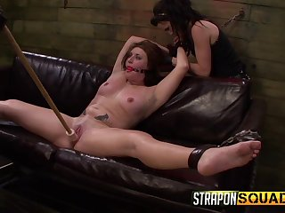 Lesbians use huge toys on their slave's ass and pussy