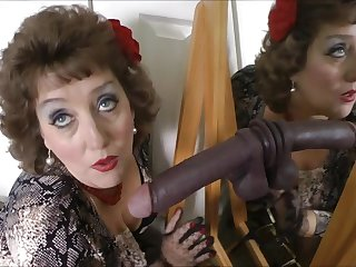 Sultry adult woman plays with black fake cock