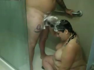 This fat bitch loves to wash his dick involving her hair and she's not camera shy