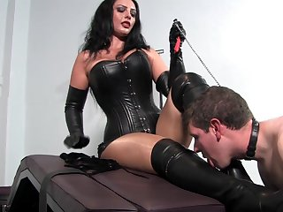 Dominant woman pleases herself with young slave dick