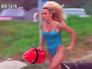 Busty babe Pamela Anderson energetic in her iconic red Baywatch swimsuit