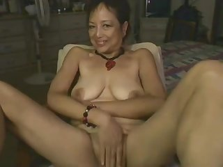 Asian Old lady Playing With Dildo On Webcam